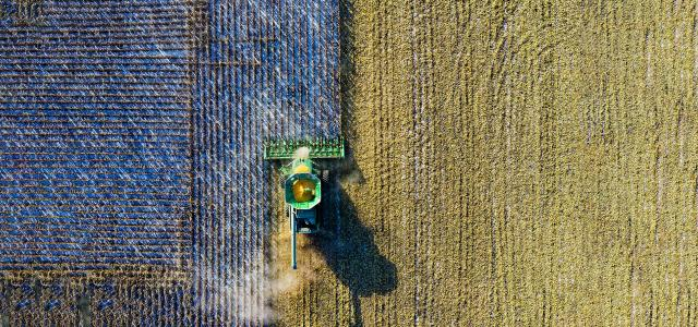 Aerial shot of green milling tractor by Tom Fisk